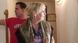 Cute busty blonde granny has fun with a young man