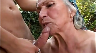 Young slutty granny fucked outdoor in her kitchen