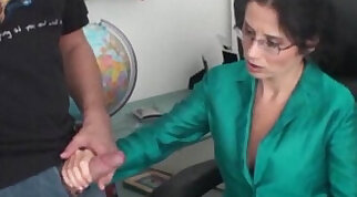 Hawt brunette MILF gives candid handjob and denial in office