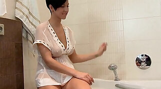 brunette that has big tits is teasing her pussy in the bath