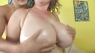 Busty milf giving titjob and cock sucking