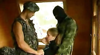 Blonde spy caught and fucked by two soldiers